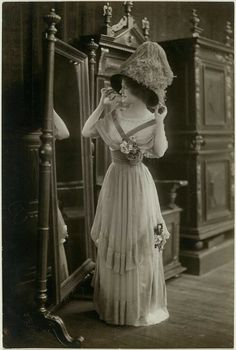 Circa 1910 lady in a fashionable dress and hat