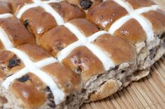Love this image: Batch of fresh spicy Hot Cross Buns with raisins and the tradirional glazed pastry cross for Easter in remembrance of the crucifixion - By stockarch.com user: easterstockphotos