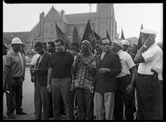 "Charles ""Teenie"" Harris, ""Black Monday"" demonstration with Mike Desmond, Rev. Jimmy Joe Robinson, Nate Smith, and Byrd Brown in front, and others including Lloyd Bell, Dr. Norman Johnson, Aaron Mann, Louis Boykins, Vince ""Roots"" Wilson in light colored hat, police officer William ""Mugsy"" Moore, James ""Swampman"" Williams, and Matthew Moore in background, Freedom Corner, Lower Hill District, September 1969, Heinz Family Fund, Teenie Harris Archive © 2006 Carnegie Museum of Art, Pittsburgh"