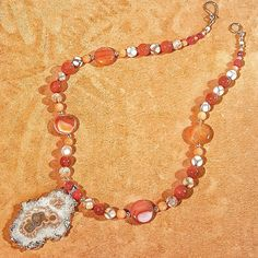 Free 2 day shipping! The perfect one of a kind Christmas gift! Sliced agate geode druzy pendant dipped in 24k gold with carnelian and agate beads, 24k gold spacerbeads and toggles! Elegant, classy, stylish and chic! Also hypoallergenic due to its purity!
