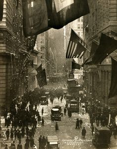 Old Glory. Flags wave over Wall Street, New York City in celebration of the surrender of Germany and the end of the Great War. W.L. Drummond, photographer, Dec 5, 1918