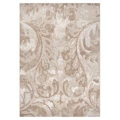 Rug with a scrolling leaf motif.Product: RugConstruction Material: 100% PolypropyleneColor: Beige, cre...