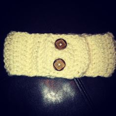 Yes, I made this! Check out my page on Facebook!! AND 'LIKE' IT! It's called The Welcome Post by Amanda Williams.  This is a cream colored adult ear warmer with wooden buttons to allow you to adjust the size to fit you perfectly. $22 (add $2.00 if shipping applies to you).