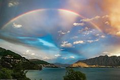 This rainbow appeared on the horizon over Queenstown's mountains after an entire day of rain. Photo by Brian Griffiths.