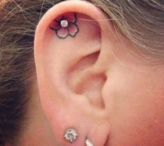Love the placement of this tattoo. #InkedMagazine #flower #tattoo #cute #piercing #tattoos #ear #Inked