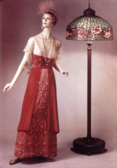 """Lamp shade dress in the """"uglies"""" mode. Many types of fabric in one dress. This is the era  of the Tiffany stained glass and Stickley's Mission furniture."""