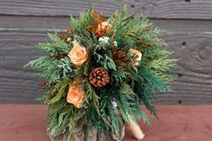 lots of mixed greens, roses and pine cones - very natural looking
