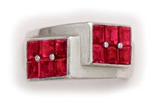 An Art Deco  Burma ruby and platinum geometric ring.             Cartier,  London.