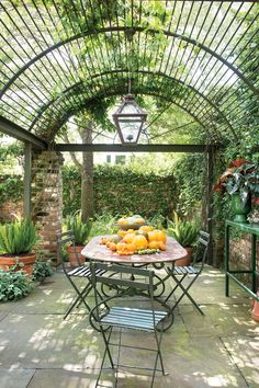 A barrel-vaulted arbor inspired by 18th-century Paris, created in metal to support vines and last longer than wood.     The Details: Because it requires less maintenance, the metal framing is better suited for being covered by vines than painted wood is.  The Plants: A delightful tangle of crossvine and star jasmine quickly covered the structure, providing cooling shade. The vines are cut back periodically in la...