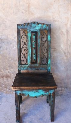 Handcrafted wood chairs with rustic finish and decorative iron inserts.