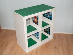White closetmaid cubical with green Lego grass glued to the bottom to make rooms (perfect for girls using LEGO Friends)