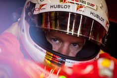 Ferrari's German driver Sebastian Vettel looks on during the first practice session at the Spa-Francorchamps ciruit in Spa on August 21, 2015, ahead of the Belgian Formula One Grand Prix. AFP PHOTO / ANDREJ ISAKOVIC / AFP / ANDREJ ISAKOVIC