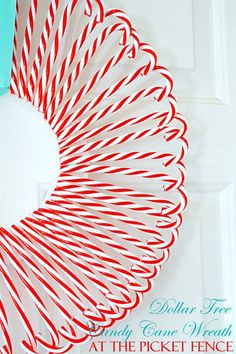 Make this cute Candy Cane Wreath from Dollar Tree candy canes and styrofoam wreath form! #easyholidayideas