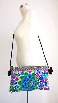 On Sale :  An Boho Style Crossbody Bag Handmade with Traditional Hmong Fabric. This bag exhibits brilliant colours with embroidered patterns of exotic