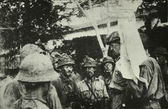 Lieutenant-General A. E. Percival, the General Officer Commanding Malaya at the Surrender Talks with Lieutenant-Colonel Sugita Ichiji. (Text from http://sg.sg/GGYm97)