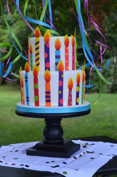 Colorful fondant candle birthday cake