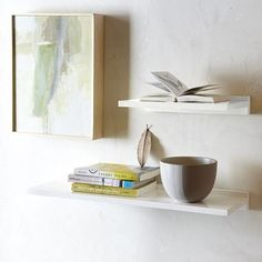 These white lacquered shelves would be perfect above a toilet.