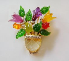 A lovely vintage Lucite flower basket brooch. #vintage #jewelry #brooches