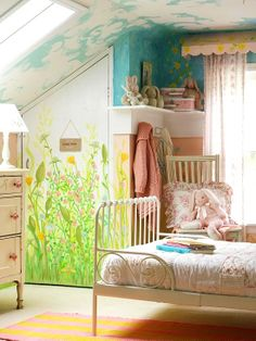 Such a cute whimsical attic bedroom.
