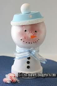 Snowman pot--another cute clay pot and glass jar project!  I couldn't find directions, but looks easy enough.