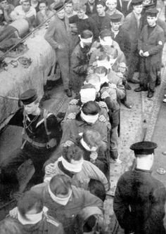 The captured crew of a U-boat are brought ashore. Naval Intelligence interviewed such men in some depth and built up a picture of the U boat service.