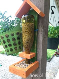 DIY Bird Feeder with scrap lumber and recycled wine bottle
