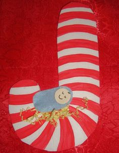 "J for Jesus Craft. Cut out a cardstock ""J"" have kids paint red stripes. Baby is made from a paper circle face (use a manilla folder) and a felt oval for body. Glue shredded paper ""hay."""