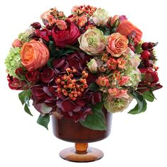 Handcrafted faux rose and hydrangea arrangement.  Product: Faux floral arrangementConstruction Material: Polyest...