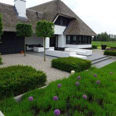 Jardines de estilo moderno por Hendriks Hoveniers