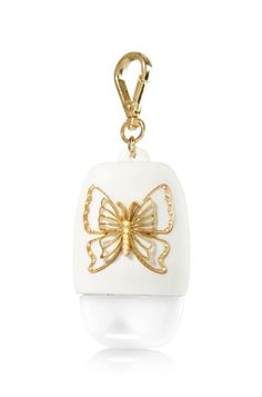 Gold Butterfly - PocketBac Holder - Bath & Body Works - A beautiful butterfly! Glitter accents and delicate gold make this holder an elegant accent for your PocketBac. A convenient clip attaches to your backpack, purse and more so you can always keep your favorite sanitizer close at hand.