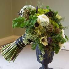 The bridal bouqet will be a loose bouquet ivory lisianthus, scabiosa pods, geranium greenery, dried wheat, seeded eucalyptus, green rosemary, green hypericum, lavender, anemones wrapped in ivory fabric with twine on top