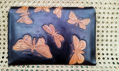 Tablet case. Back with MC Escher's butterfly tessellation. Lined with calf skin. Hand stitched.  ZAR2700
