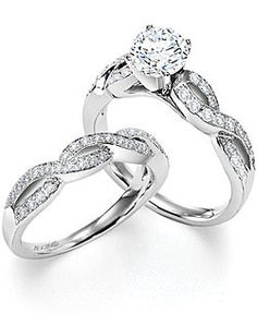 Hey! That's just like my ring! I haven't figured out what I'm going to do for a band yet (either a matching band like this, a band that mirrors the shape, or two straight bands on either side.)