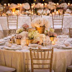 Pastel colour flowers in gold vases centerpiece
