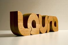 Nuzzles® - Wooden Typographic Puzzles by John Christenson, via Behance