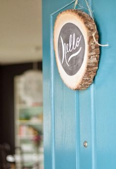15 Ways to DIY With Wood Slices via Brit + Co. hello wreath