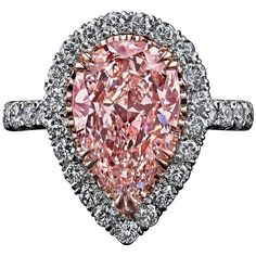 Beautifully made, and pink! K. 1.72 Carat GIA Cert Fancy Light Pink Diamond Gold Platinum Halo Engagement Ring | From a unique collection of vintage engagement rings at https://www.1stdibs.com/jewelry/rings/engagement-rings/