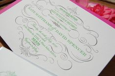 engraved green invitations on gray with pink envelope