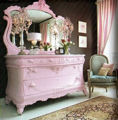 Unashamedly feminine. Pink dresser and pink striped curtains!!