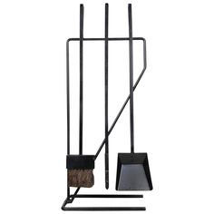Minimal Modernist Wrought Iron Fireplace Tools after George Nelson | From a unique collection of antique and modern fireplace tools and chimney pots at https://www.1stdibs.com/furniture/building-garden/fireplace-tools-chimney-pots/