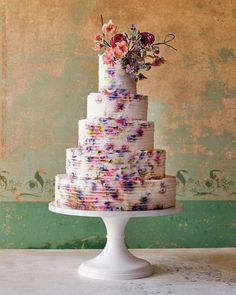 "Gorgeous Floral Wedding Cakes by Maggie Austin | Martha Stewart Weddings - Ribbon-Wrapped Watercolor: ""After making countless tiers covered with ruffled frills, I developed this sleeker and decidedly less girlish variation using fondant strips."""