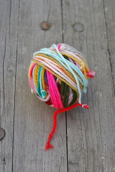 tie all the scrap yarn together into a new ball - by wood & wool stool