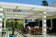 A Vergola roof that we have for the middle portion of our patio cover.  It is an opening and closing louver system that closes automatically when it begins to rain.  Then on both sides of the Vergola we have stationary slats so the whole back side of our house has a patio cover.  We love the Vergola as we can choose when we want it opened or closed.  Took us a long time to find something that would work well for us.  Ours looks much nicer because my husband designed it with some curves.