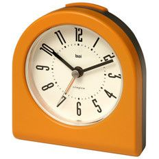 Rise and shine! This retro-inspired alarm clock in Tangerine is the ideal nightstand accent.