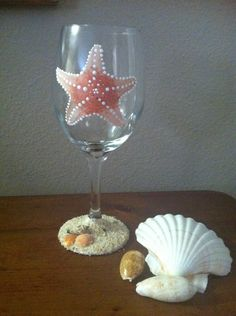 Beach wine glass with sand Looking for unique beach gifts? Consider this painted wine glass with a beautiful starfish painted in shades of cream
