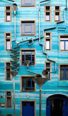 Dresden, Germany. The building facade Neustadt Kunsthofpassage is all covered with steel funnels and channels that transform the sound of rain water into music.