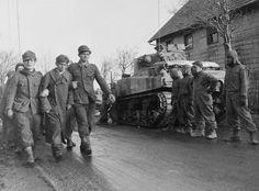 The crew of a Sherman tank watches passing German prisoners of war. German Soldiers Ww2, German Army, Army History, Tank Watch, Sherman Tank, Tank Destroyer, Ww2 Photos, History Images, Prisoners Of War