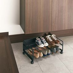 This Shoe Wagon by Yamazaki can store a large amount of shoes, and roll under a cabinet to save space and even hide shoes from view in a busy entranceway. When ready to wear shoes, simply roll it out, and then roll it back in. It contains wheels and is easy to move around and can hold many shoes. Hides shoes from view of guests. Made of steel, designed in Japan.