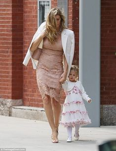 Matching: The mother-daughter duo both wore pink and white ensembles to the intimate famil...