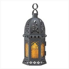 Yellow glass panes framed with black iron, this Moroccan Lantern Lamp Candleholder with stamped glass panels is perfect for adding some candle light to your party whether it is indoors or outside! #HomeLocomotion #MoroccanLantern